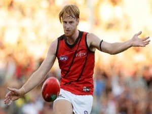 AARON FRANCIS of the Bombers kicks the ball during the AFL match between the Fremantle Dockers and the Essendon Bombers at Domain Stadium in Perth, Australia.