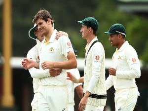 AARON HARDIE of CA XI celebrates with team mates after taking the wicket of Virat Kohli of India during the four day International Tour Match between the Cricket Australia XI and India at SCG in Sydney, Australia