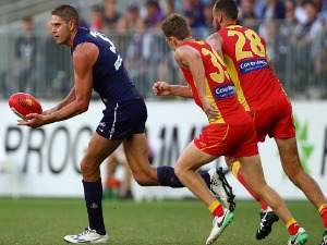AARON SANDILANDS of the Dockers handballs during the AFL match between the Gold Coast Suns and the Fremantle Dockers at Optus Stadium in Perth, Australia.