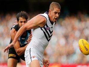 PADDY RYDER of the Power tackles AARON SANDILANDS of the Dockers during the 2017 AFL match between the Port Adelaide Power and the Fremantle Dockers at Adelaide Oval in Adelaide, Australia.