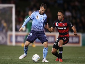 ADAM LE FONDRE of Sydney FC is challenged by Tarek Elrich of the Wanderers during the FFA Cup match between the Western Sydney Wanderers and Sydney FC at Panthers Stadium on in Penrith, Australia