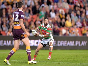 ADAM REYNOLDS of the Rabbitohs looks to pass during the NRL match between the Brisbane Broncos and the South Sydney Rabbitohs at Suncorp Stadium in Brisbane, Australia.