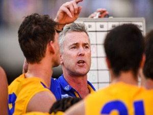 ADAM SIMPSON, coach of the Eagles addresses the team at quarter time during the 2018 AFL match between the Fremantle Dockers and the West Coast Eagles at Optus Stadium in Perth, Australia.