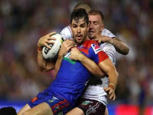 AIDAN GUERRA of the Knights is tackled during the NRL match between the Newcastle Knights and the Manly Sea Eagles at McDonald Jones Stadium in Newcastle, Australia.
