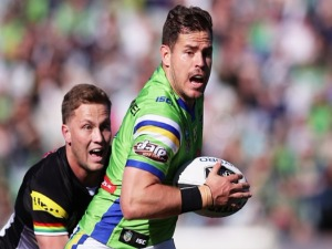 AIDAN SEZER of the Raiders gets away from MATT MOYLAN of the Panthers during the NRL match between the Canberra Raiders and the Penrith Panthers at GIO Stadium in Canberra, Australia.
