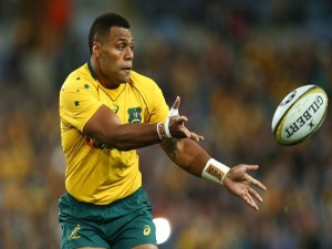 ALLAN ALAALATOA of the Wallabies passes during The Rugby Championship Bledisloe Cup match between the Australian Wallabies and the New Zealand All Blacks at ANZ Stadium in Sydney, Australia.