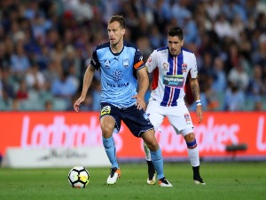 ALEX WILKINSON of Sydney FC dribbles the ball during the A-League match between Sydney FC and the Newcastle Jets at Allianz Stadium in Sydney, Australia.