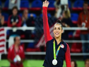 ALEXANDRA RAISMAN of the United States celebrates on the podium at the medal ceremony for the Women's Individual All Around Final on Day 6 of the 2016 Rio Olympics at Rio Olympic Arena in Rio de Janeiro, Brazil.