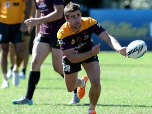ANDREW MCCULLOUGH passes the ball during a Brisbane Broncos NRL training session in Brisbane, Australia.