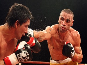 ANTHONY MUNDINE of Australia throws a punch at Carlos Jerez of Argentina during their WBA International junior middleweight fight in Brisbane, Australia.