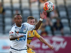 ARCHIE THOMPSON of the Victory contests the ball with his Mariners opponent during the A-League match between the Central Coast Mariners and the Melbourne Victory at Central Coast Stadium in Gosford, Australia.