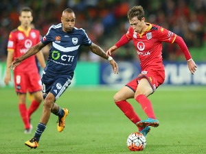 ARCHIE THOMPSON of the Victory and Craig Goodwin of United competes for the ball during the A-League match between Melbourne Victory and Adelaide United at AAMI Park in Melbourne, Australia.