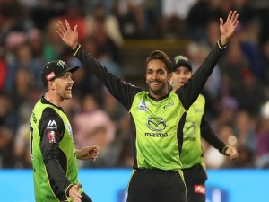 ARJUN NAIR of the Thunder celebrates taking the wicket of Matthew Wade of the Hurricanes during the Big Bash League match between the Hobart Hurricanes and the Sydney Thunder at University of Tasmania Stadium in Launceston, Australia.