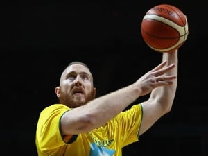 ARON BAYNES of the Boomers warms up prior to the match between the Australian Boomers and the Pac-12 College All-stars at Hisense Arena in Melbourne, Australia.