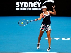 ASHLEIGH BARTY of Australia plays a forehand against Angelique Kerber of Germany during the 2018 Sydney International at Sydney Olympic Park Tennis Centre in Australia.