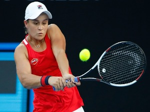 ASHLEIGH BARTY of Australia plays a backhand against Camila Giorgi of Italy of the 2018 Australian Open at Melbourne Park in Australia.