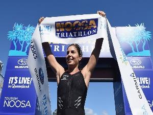 ASHLEIGH GENTLE celebrates winning the Noosa Triathlon in Noosa, Australia.
