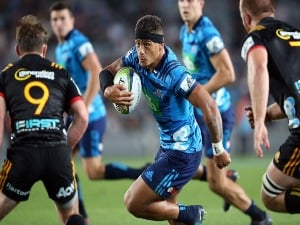 AUGUSTINE PULU (C) of the Blues makes a break during the Super Rugby match between the Blues and the Chiefs at Eden Park in Auckland, New Zealand.