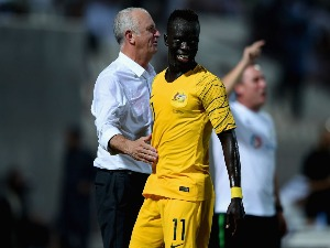 AWER MABIL of Australia celebrates with his coach Graham Arnold scoring his sides fourth goal during the International Friendly match between Kuwait and Australia at Al Kuwait Sports Club Stadium in Kuwait City, Kuwait.