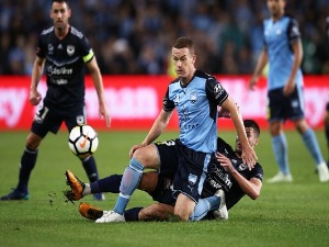 BRANDON O'NEILL of Sydneycompetes with Terry Antonis of the Victory during the A-League Semi Final match between Sydney FC and Melbourne Victory at Allianz Stadium in Sydney, Australia.