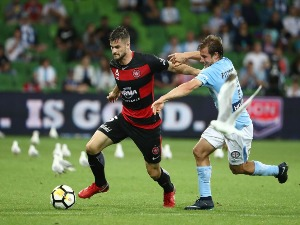 BRENDAN HAMILL of the Wanderers is challenged by NICK FITZGERALD of the City during the A-League match between Melbourne City and the Western Sydney Wanderers at AAMI Park in Melbourne, Australia.