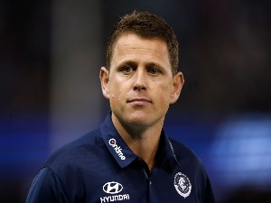 BRENDON BOLTON, Senior Coach of the Blues looks on during the AFL match between the Western Bulldogs and the Carlton Blues at Etihad Stadium in Melbourne, Australia.