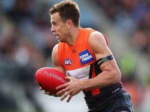 BRETT DELEDIO of the Giants carries the ball during the AFL match between the Greater Western Sydney Giants and the Melbourne Demons at UNSW Canberra Oval in Canberra, Australia.