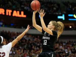 BRITTANY MCPHEE #12 of the Stanford Cardinal shoots against Tyasha Harris #52 of the South Carolina Gamecocks during the NCAA Women's Final Four at AAC in Dallas, Texas.