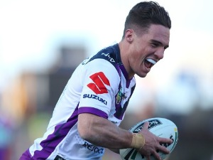 BRODIE CROFT of the Storm scores a try during the NRL match between the Newcastle Knights and the Melbourne Storm at McDonald Jones Stadium in Newcastle, Australia.