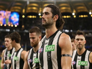 BRODIE GRUNDY of the Magpies walks from the ground after being defeated during the AFL Second Qualifying Final match between the West Coast Eagles and the Collingwood Magpies at Optus Stadium in Perth, Australia.
