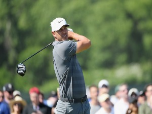 BROOKS KOEPKA of the United States plays his shot during the 2018 U.S. Open at Shinnecock Hills Golf Club in Southampton, New York.