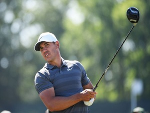 BROOKS KOEPKA of the United States plays his shot from the ninth tee during the 2018 U.S. Open at Shinnecock Hills Golf Club in Southampton, New York.