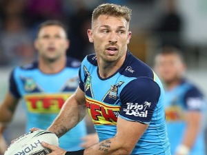 BRYCE CARTWRIGHT of the Titans runs the ball during the NRL match between the Gold Coast Titans and Cronulla Sharks at Cbus Super Stadium in Gold Coast, Australia.