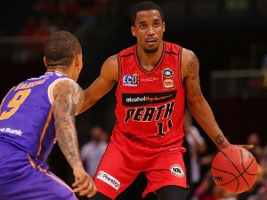 BRYCE COTTON of the Wildcats dribbles the ball during the NBL match between the Sydney Kings and the Perth Wildcats at Qudos Bank Arena in Sydney, Australia.