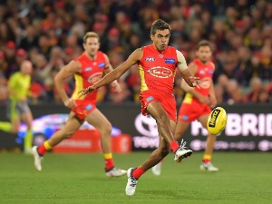 CALLUM AH CHEE of the Suns kicks the ball during the AFL match between the Adelaide Crows and Gold Coast Suns at Adelaide Oval in Adelaide, Australia.