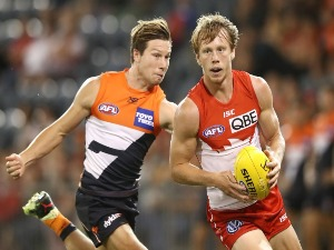 CALLUM MILLS of the Swans is tackled by TOBY GREENE of the Giants during the JLT Community Series AFL match between the Sydney Swans and the Greater Western Sydney Giants at Blacktown International Sportspark in Sydney, Australia.