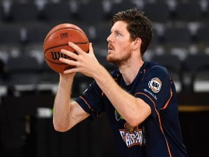 CAM GLIDDON of the Taipans warms up before the start of the NBL match between the Cairns Taipans and the Perth Wildcats at CCC in Cairns, Australia.