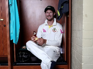 CAMERON BANCROFT of Australia celebrates with the Ashes Urn in the change room during the Fifth Test match in the 2017/18 Ashes Series between Australia and England at SCG in Sydney, Australia.