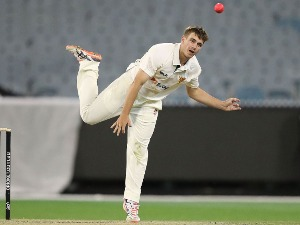 CAMERON BOYCE of Tasmania bowls during day three of the Sheffield Shield match between Victoria and Tasmania at the Melbourne Cricket Ground in Melbourne, Australia.