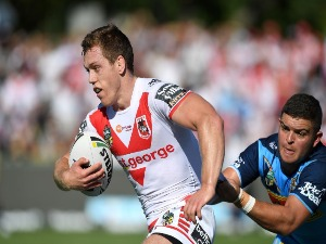 CAMERON MC INNES of the Dragons attempts to break away from the defence during NRL match between the Gold Coast Titans and the St George Illawarra Dragons at Clive Berghofer Stadium in Toowoomba, Australia.