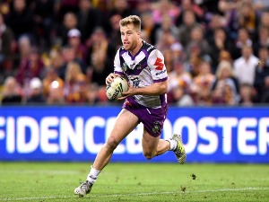 CAMERON MUNSTER of the Storm runs with the ball during the NRL match between the Brisbane Broncos and the Melbourne Storm at Suncorp Stadium in Brisbane, Australia.