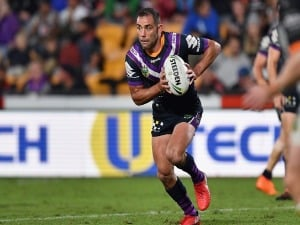 CAMERON SMITH of the Storm charges forward during the NRL match between the Wests Tigers and the Melbourne Storm at Mt Smart Stadium in Auckland, New Zealand.