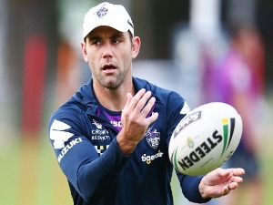 CAMERON SMITH of the Storm passes the ball during a Melbourne Storm NRL training session at AAMI Park in Melbourne, Australia.