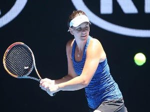 CASEY DELLACQUA of Australia plays a backhand in his first round match with Matt Reid of Australia against Barbora Krejcikova of the Czech Republic and Rajeev Ram of the United States of the 2017 Australian Open at Melbourne Park in Melbourne, Australia.