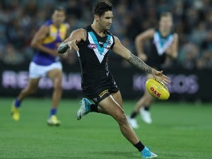 CHAD WINGARD of the Power kicks the ball during the AFL match between the Port Adelaide Power and the West Coast Eagles at Adelaide Oval in Adelaide, Australia.