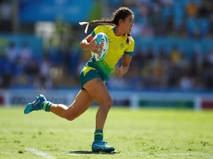 CHARLOTTE CASLICK of Australia runs during women's Rugby Sevens semi final match between Australia and Canada of the Gold Coast 2018 Commonwealth Games at Robina Stadium in the Gold Coast, Australia.