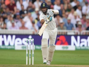India batsman CHETESHWAR PUJARA drives during the Test Match between England and India at Trent Bridge in Nottingham, England.