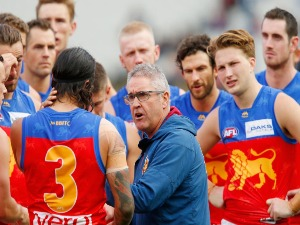 CHRIS FAGAN, senior coach of Brisbane speaks to his players during the AFL match between the Richmond Tigers and the Brisbane Lions at MCG in Melbourne, Australia.