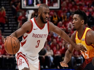 CHRIS PAUL #3 of the Houston Rockets drives past the defense of Donovan Mitchell #45 of the Utah Jazz in the second half during the 2018 NBA Playoffs at Vivint Smart Home Arena in Salt Lake City, Utah.