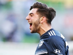 CHRISTIAN THEOHAROUS of the Victory celebrates after he scored a goal during the A-League match between the Melbourne Victory and the Central Coast Mariners at AAMI Park in Melbourne, Australia.